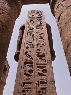 Luxor temple: stela behind a statue of King Rameses II, with his double Shennu (cartouches) at the top. Thebes, Upper Egypt.