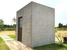 アンティーク照明付きインダストリアルデザインのガーデンシェッド,モルタル製小屋,コンクリート小屋