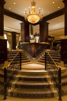 Amazing staircase with gorgeous chandelier...