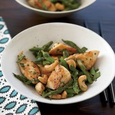 Chicken Stir-Fry with Asparagus and Cashews | Cashews contain oleic acid, the same monounsaturated fat that makes olive oil so heart-healthy. This chicken-cashew stir-fry gets its Asian flavors from a bright mix of fish sauce, oyster sauce and basil—and just a little oil.