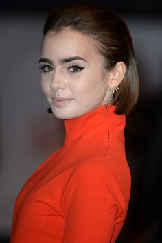 Lily Collins With A Swept Back Glossy Bob