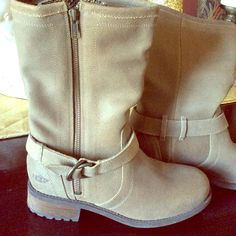 Ugg Tan Boots sz 8 New never worn no tag or box wool on bottom side zipper . The ankle area was a lil tight for me so I had to sell before I even got to wear these adorable Uggs. Sticker is still on bottom of boot. They contain Ugg pure wool the sticker on bottom of boot states that . UGG Shoes