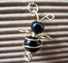 Adorable bead and wire work bee.  cbee charm | JewelryLessons.com