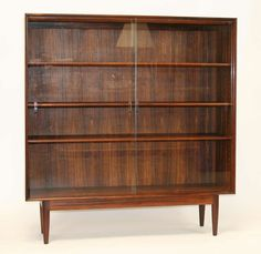 Danish Rosewood Bookcase   From a unique collection of antique and modern bookcases at https://www.1stdibs.com/furniture/storage-case-pieces/bookcases/