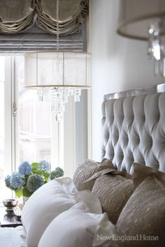 Tufted headboard and chandelier