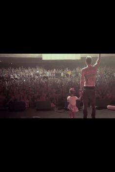 Machine Gun Kelly and his daughter on stage.