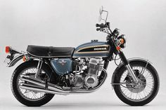 My father used to have one of those. In all-black! Crazy bike with all 4 original pipes making crazy noise! 1974 Honda CB750/four (below), the four-pipe K-series.