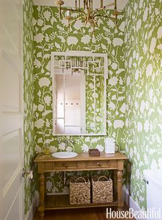 """""""A powder room is a great place to make a big wallpaper statement. This one, from Quadrille, has pizzazz and wraps itself around you.""""   - CountryLiving.com"""