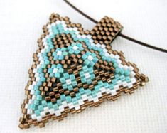 Peyote Triangle Pendant in Blue White and Silver by MadeByKatarina