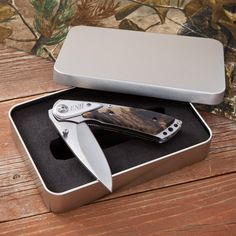 Camo pocket knife: definitely a great groomsman gift for a redneck wedding
