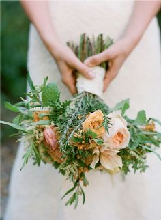 Sprigs of rosemary and faded orange blooms were rich details for a Halloween wedding bouquet at @Four Seasons Resort The Biltmore Santa Barbara.