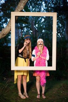 Hang a giant picture frame from a high tree and make a fun photo booth.