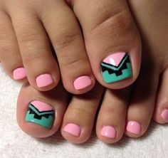 Pink, green and black tribal inspired toenail art design, this design is very simple but surely does the job. The nails use a baby pink nail polish as base color. The big toenail is topped with a v-shaped thick French tip lined with black polish and tribal designs.