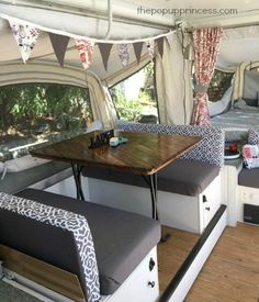 Teresa's Pop Up Camper Remodel - The Pop Up Princess I am obsessed with the bunting, patterned backs and solid bottom.