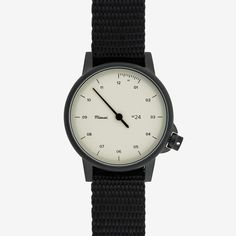 You Hate: That he never takes off that fitness tracker. Buy Him: A sporty watch with a flexible band (so he can still run with it!) that isn't too fancy. Miansai M24 Noir/Bone Watch on Black Nylon Strap, $185; miansai.com   - ELLE.com