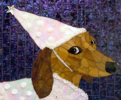 This mosaic of a dachshund princess fits the breed. The artist was able to get the look that we all know so well!