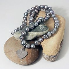 This stunning Freshwater Pearl Grey Necklace makes a special gift for any occasion!
