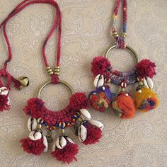 cowries and wool charm - similar to a dreamcatcher