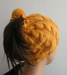 I like this idea, i'm gonna make a hat so my ponytail can stick out the top :P