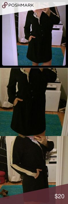 Black and white tie at waist shirt dress. This is a very cute work dress,  crape like fabric gives is a soft flow. Contrast black and white with metal cube buttons. Size Medium, would fit a small 2-4 as well. fable Dresses Mini
