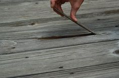 How to Resurface Cracked & Splintered Wood Decks. Rain makes the wood swell and warp, and the sun dries it out and makes it crack. As long as the wood isn't Wood Decks, Diy Deck, Lawn And Garden, Diy Home Decor, Corner, House Design, Backyard Ideas, Front Porch, Outdoors