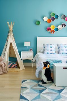 This kids bedroom is full of colour, especially the floating hexagon shelves!