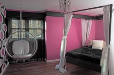 that almost looks like a suspended bed. i would have killed for this room when i was little.