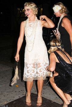 Julianne Hough in a flapper style dress complete with makeup and headband.