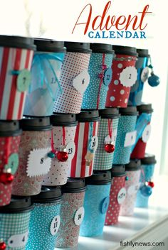 Fishly News: Advent calendar. Cups covered in scrapbook paper - really cute idea.