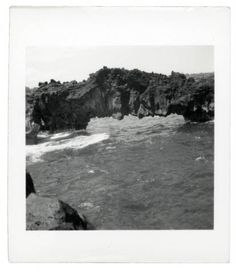 "Georgia O'Keeffe, ""Natural Stone Arch, Wai'anapanapa State Park, Hawaii,"" 1939. Photographic print, 2 1/2 x 2 7/8 in. Georgia O'Keeffe Museum. Gift of The Georgia O'Keeffe Foundation. 2006-06-1096. Copyright Georgia O'Keeffe Museum."