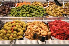 """Lincoln Park Whole Foods opens with lots of neighborhood flavor. Chicago Tribune's Judy Hevrdejs reports from the scene. Shown here: """" Olive bar. Bright colors adorn the olive bar Wednesday at the new Whole Foods in Lincoln Park. (Anthony Souffle, Chicago Tribune)"""" http://www.chicagotribune.com/lifestyles/food/ct-whole-foods-lincoln-park-20150225-story.html"""