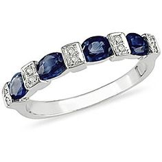Sapphire ring I have in gold.  Looking for a complimentary ring to wear with it.