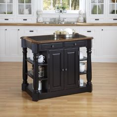 Home Styles 5091-94 Americana Granite Kitchen Island  Step into a comfortable surrounding that is Americana. Rustic design elements are apparent in the strong lines of the raised panel doors and hand-applied antiqued black rubbed through finish providing an aged worn look. Constructed of hardwood solids and engineered wood with a ¾ inch inlay granite top. The Americana Granite Kitchen Island features a physically distressed oak finished top featuring worm holes, fly specking and smal..