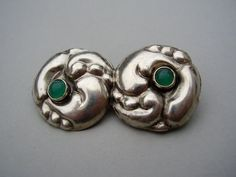 Skønvirke silver and green chrysoprase or green glass brooch. The brooch is marked for 830 out of a 1000 parts silver and was most likely made in Copenhagen, Denmark, in around 1910. This piece shows a similarity to jewellery designs by the Danish architect and designer Thorvald Bindesbøll (1846-1908). Sold on Etsy: https://www.etsy.com/listing/165080240/antique-danish-skonvirke-thorvald?ref=shop_home_active