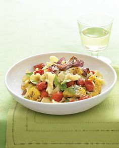A bit of butter, parmesan cheese, and fresh basil transforms roasted vegetables into a flavorful sauce for pasta. You could easily modify this recipe to use any vegetables that are in season.