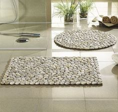 DIY Stone Carpet-- - a rubber welcome mat; • some contact adhesive; • four bags of river rocks;