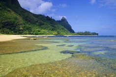 This scenic tropical beach is Tunnels Beach on the island of Kauai is one of the best snorkeling locations in the Hawaiian Islands.