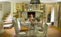 kitchen table with view of fireplace and framed prints above