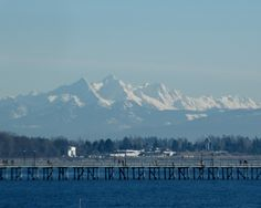 """Baker View"" March 2012 Photography by Heather Lyn Sparrow. Mount Baker WA bathed in snow and sunshine; looking East from White Rock BC Canada."