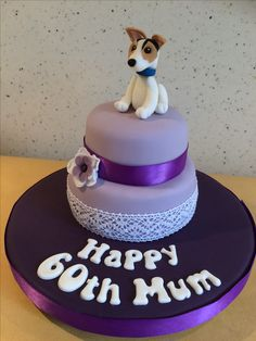 Small two tier purple cake with Jack Russell