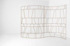 PARAVENTO 056 - DIMORE GALLERY. DIMORESTUDIO, PROGETTO NON FINITO. Lattice composed of two curved elements in oxidized brass.  w.270 x d.78 x h.200 cm