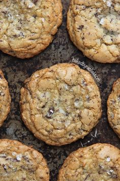 Chewy coconut chocolate chunk cookies, topped off with flaked sea salt. A must try cookie from @Rachel {Baked by Rachel}