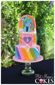 Rainbow Dash My Little Pony Cake. Pretty two tiered Birthday Cake. The perfect centre piece for a My Little Pony Birthday Party. For another image go to http://www.pinterest.com/pin/374784000214081883/