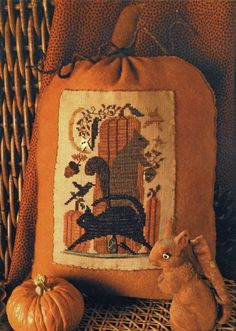 Not so enthused about the picture but the idea of the pumpkin as a pillow with a design......................Autumn Gathering Cross Stitch Design and by HomespunElegance