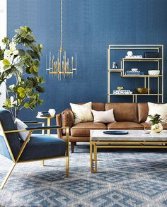Moody Sophistication—That gold-based velvet armchair is what dreams are made of, and the commonly used blue palette is given new life by the pale pink throws and caramel leather sofa.