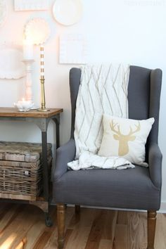 Simple Christmas Decorating - Gray Wingback Chair with Gold Reindeer Pillow