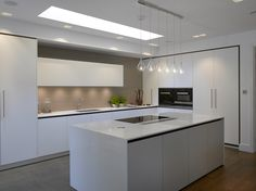 This contemporary, all-white kitchen is full of sophistication with sleek handleless draws and composite stone surfaces All White Kitchen, Open Plan Kitchen, Kitchen Ideas, Kitchen Designs, White Kitchens, Grand Kitchen, Kitchen Dinning Room, Luxury Kitchen Design, Luxury Kitchens