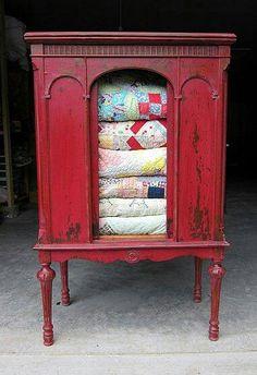Red antique quilt holder More