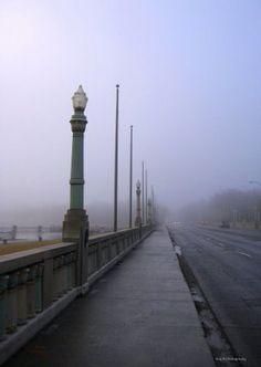 Regina, Saskatchewan. The famous Albert Street bridge on a cool foggy autumn morning. This bridge holds the world record for longest bridge over shortest body of water.