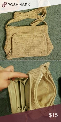 Beige woven crossbody bag this bag is small but has a lot of pockets! basically a wallet on the outside and has an extra zipper pocket on the inside. worn a few times but in great condition! Bags Crossbody Bags